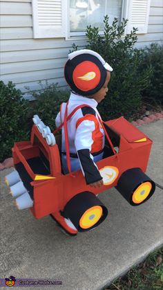 Queda: The costume idea came from Josiah's favorite cartoon show, Blaze and the Monster Machines. Josiah is dressed as AJ(the driver of Blaze) and Blaze is made out of a cardboard...