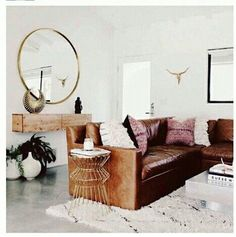 A brown leather couch is usually a bachelor pad staple. We love the way this room has made this rugged piece a little more...