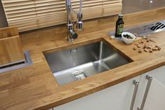 Solid Oak worktop with Franke under-mount stainless steel sink.