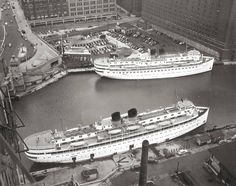 Great Lakes Passenger Steamers the S.S. NORTH AMERICAN (Top) and its sister ship the S.S. SOUTH AMERICAN docked in the Chicago River during the summer of 1958.