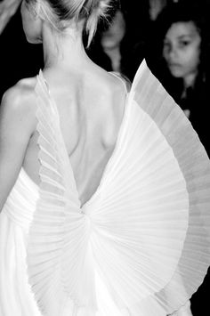 deep back v with pleated wings