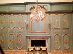 Walls with ornate moulding that are actually storage cabinets from a Parisian apartment.  These are just like the ones in Audrey Hepburns apartment in the movie Charade.