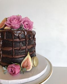 Chocolate naked wedding cake with ganache drip, figs and roses. Cake by Lotz of Sweets Bakery. Florals by Love & Luster
