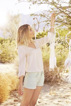 Pair a breezy peasant top with bleached denim cutoffs for carefree, California style like LC Lauren Conrad.