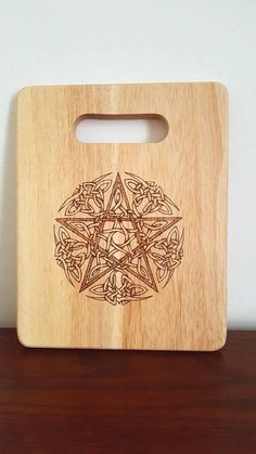 Check out this item in my Etsy shop https://www.etsy.com/uk/listing/570065051/celtic-pentagram-chopping-board-serving