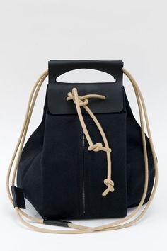big black canvas pop-up bag with leather handles