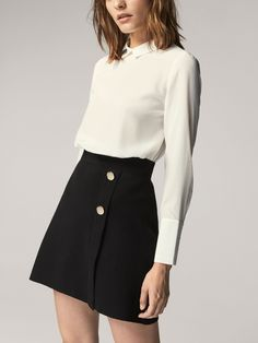 White blouse and black bottoms - classic styling  Plain silk blouse from Massimo Dutti