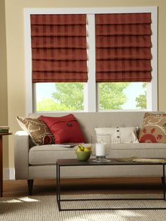 Go bold with satin striped roman shades.
