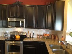 Paint burnt orange over cabinets after finishing cabinets with  espresso