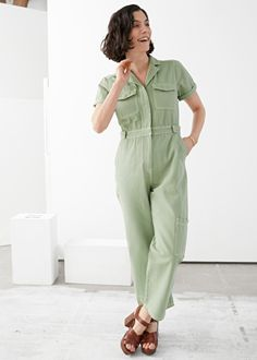 Shortsleeved denim jumpsuit with workwear details in a relaxed straight silhouette. Slanted side pocketsPatch pockets at chest, back and legLength of inseam: / (Size wears: height: / Shearling Slippers, Tracee Ellis Ross, Boiler Suit, Fashion Project, Denim Jumpsuit, Fashion Story, Braided Leather, Playsuits, Work Wear