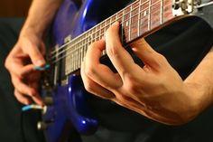 Guitarist playing chords