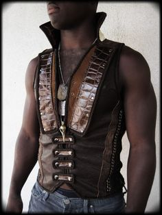 Lux tux style leather mens reversible vest. Brown leather and black leather. High collar. Custom order design by Ahni Radvanyi for Resonating Threads Shop. https://www.etsy.com/shop/ahniradvanyi