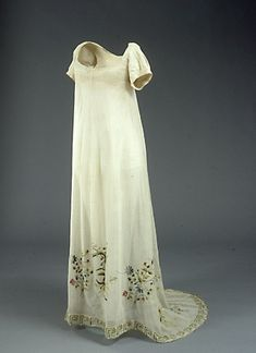 During the Regency era there were any number of ways to embellish a gown, from printing or painting directly on the fabric, to adding lace and other accents, or even embroidery. One method of embroidery, Tambour Work, was especially popular for it's ease of application. Tambour is French for drum, and refers to the method of creating the embroidery. | Jane Austen Centre (Tambour-embroidered ecru cotton gauze wedding dress, 1817)