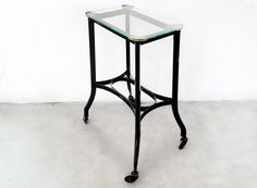 Art Deco Metal Rolling Side Table with Glass Top, 1920s by RehabVintageLA on Etsy https://www.etsy.com/listing/499150753/art-deco-metal-rolling-side-table-with