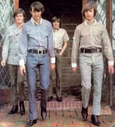 "Monkees Micky Dolenz, Mike Nesmith, Davy Jones and Peter Tork model their JCPenney threads, which Peter has described as ""a pain in the ass!"" At least he got to wear his signature-style belt buckle on the side."