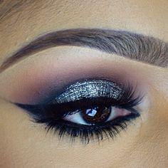Platinum glitter smokey eye .