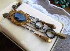 Vintage cameo assemblage necklace Midnight Blue Maiden glass cameo in brass montana blue rhinestone and crystals crystal brass drops OOAK by triolette on Etsy Cameo Jewelry, Jewelry Necklaces, Faceted Crystal, Vintage Rhinestone, Blue Crystals, Midnight Blue, Montana, Brass, Pendant