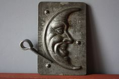 This is a two part mold of a smiling moon stamped with the name MONOS the Czech Republic agent for Anton Reiche, Germany with mold The mold measures 3 high and wide, with the two halves fitting perfectly together.