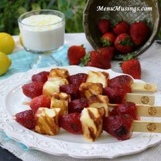 Grilled Strawberry Shortcake Kabobs--Menu Musings of a Modern American Mom:  Strawberry shortcake on a stick?  Face it, we all enjoy eating food off of a stick. Don't you know a kid (maybe even a big person) who would enjoy eating this cool dessert?  Even if its a dinner party out on the back deck... these will steal the show!  Then you get to DIP it!  That's another kid favorite thing... something to dip.  We whipped up a batch of lemon scented sweetened whipped cream