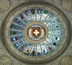 The 22 cantonal coats of arms in the Stained glass dome of the Federal Palace of Switzerland (ca. 1900)