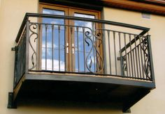 http://metal-balcony-railings.ironwroughts.com/images/wrought-iron-balcony-design-1.jpg