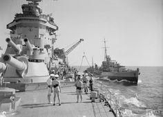 HMS Warspite, fuelling an escort.