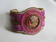 Brilliant Pink and Gold Bead Embroidery Cuff Bracelet by SimplyBeadedTreasure on Etsy https://www.etsy.com/listing/186282297/brilliant-pink-and-gold-bead-embroidery