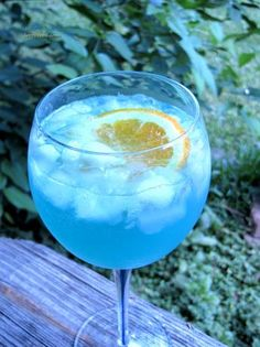 Pacific Blue Sangriaa ~ 1 (750 ml) bottle Dry White Wine, 1/2 cup Blue Curacao, 1/2 cup Fresh Lemon Juice, 1/2 cup Simple Syrup (1 part sugar, 1 part water), 2 Oranges, cut into wheels, 1 cup Pineapple Chunk, Carbonated Lemon-Lime Beverage, as needed, (7-Up)