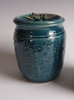 I threw this jar on the wheel and then the texture was applied to the outside using a textured roller. The beautiful, rich teal blue glad really