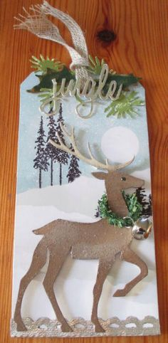 n2s : i like the trees stamped in the background ♥ Winter tag inspired by Tim Holtz: Sizzix Prancing Deer die and snowy scene