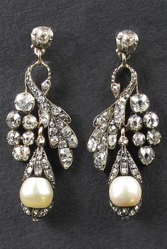 A pair of Victorian silver topped, yellow gold, diamond and natural pearl earrings in the shape of peacocks, English, circa 1850. #Victorian #antique