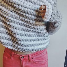 This crochet pattern is for a fluffy, cozy, bobble sweater! So named for the bitty bobbles that make up this gorgeous textured sweater! The sweater features a bobbled front panel, contrasting color blocked sleeves and back – and also features ribbed cuffs and waist.
