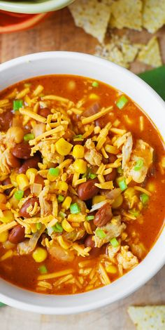 White Chicken Chili with Pinto Beans, Chickpeas, and Corn. Topped with Mexican (or Cheddar) shredded cheese, crushed tortilla chips, and sour cream. Easy and delicious! gluten free recipe.