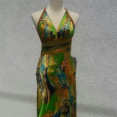 Size 2 prom dress / silky designer gown! Hand beaded, georgous colors with satin gold lining.  Worn for about three hours.  Has bustle hooks and a fishtail train.  Cleavage was stitched up about 1 1/2. Inches for modesty and can be removed very easily if you want.  Selling for a fraction of the price, she will never wear it again.  Someone needs to love this beauty!! other Dresses Prom