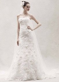 Take everyone's breath away as you walk down the aisle is this stunning fitted trumpet gown with subtle pink flower applique flowers and lace. Oleg Cassini at David's Bridal Style CWG464.