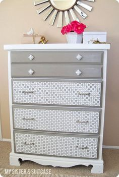 Updated dresser with paint and decorative metal sheets. Remodelaholic.com #dresser #paint #gray #white