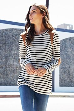 We love black and white stripes and we love elbow patches! This long sleeve knit top has all those details along with suede shoulder points.