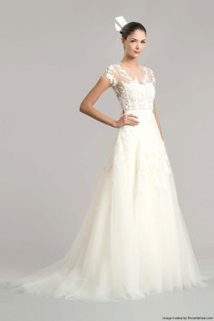 Carolina Herrera Fall 2015 lace A-line wedding dress with cap sleeves high illusion neckline and sweetheart bodice