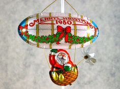 Love the tin Hallmark ornaments...