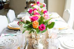 Floral and leopard tablescape by Randi Garrett Design