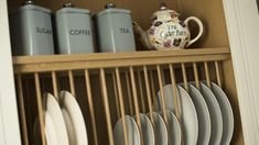 Pretty plate rack at Cyder Barn, a luxury self-catering holiday home for two in Cornwall #kitchen #plates #platerack #emmabridgewater #teapot #vintagestyle #countrychic