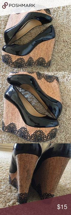 Barely Worn High Heel Platform Wedge Cute scroll design on the cork. Worn a couple of times, as these are too loose for me in the heel. I so wish they fit me. I'm a 5.5 to 6, and these are loose! Gianni Bini Shoes Wedges