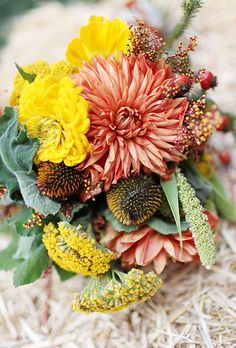 Brides.com: . Arrangement of dahlias, solidago, millet, and hypericum berries. Bouquet by The Perfect Petal