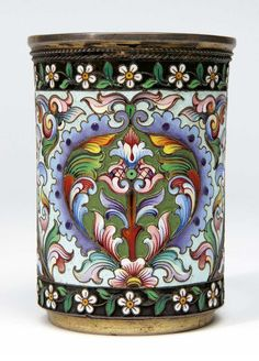 A RUSSIAN SILVER GILT AND CLOISONNE ENAMEL BEAKER, MOSCOW 1896-1908 the sides decorated with polychrome enamel scrolls and foliage within a border of trailing flowers inscription to the base dated 1908, 84 standard, maker's initials 'MC' and no. 368 7.2cm high