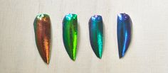 unique material : jewel beetle wing(玉虫の羽根)     While mother of pearl is the main material used in the najeon (raden) technique, the wings of the jewelbug have also been used. The color of the wings can vary from a red coppery color, green, blue green, purple, etc. RED & YELLOW  'JEWEL BEETLE WING' RED & YELLOW  'JEWEL BEETLE WING'
