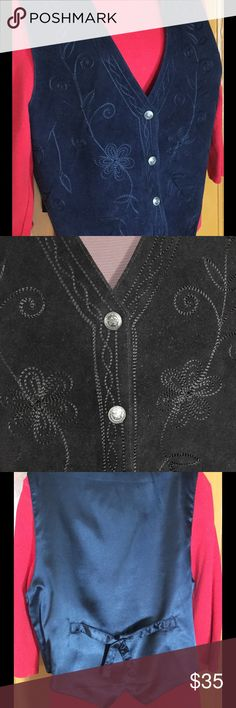 """Vintage 70s Genuine Leather Embroidered Vest Wow...so pretty and wonderfully constructed. Navy blue leather vest with gorgeous machine embroidery. Vintage 1970s. Snap buttons down the front. Satin-backed with adjustable tie...very classic. Notched and angled hem.  Leather front/polyester lining. Bust 38""""  Hip 36"""" Length 22"""". Add a great Blouse or tee and a pair of jeans, and you have a great fall look. Fabulous material and construction. True dark navy...closeup is just slightly darker than…"""