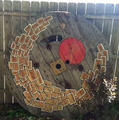 Large wooden spool end, made into garden art
