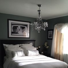 Bedroom- Matte grey walls. Great black and white couple, engagement, or wedding photo above headboard. Crystal chandelier.