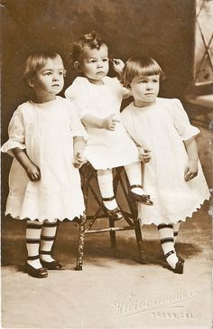 Three Sisters - the striped sock girls are non-identical TWINS.