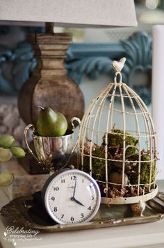 Chippy cream birdcage, clock, silver trophy on a silver tray, details from a {Turquoise Mirror & Antique Chest Makeover} Painting with Annie Sloan Chalk Paint